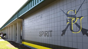 South Umpqua High School students walk past a newly painted front facade at the Tri-City school on Tuesday, May 16, 2017.
