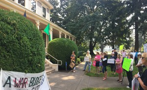 A rally held Tuesday outside of U.S. Rep. Jaime Herrera Beutler's Vancouver Office. Protesters from thepolitical groupIndivisible are demanding Herrera Beutler hold an in-person town hall.