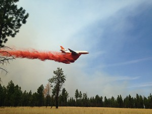 A heavy air tanker flies over the Milli Fire in the Three Sisters Wilderness in Central Oregon.