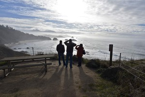 Visitors take in a view of the Pacific Ocean at Ecola State Park on the Oregon coast.