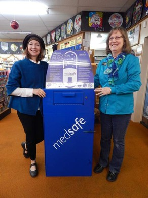 Liz Marvin, left, and Cathy Putnam show off a new medication disposal dropbox at Carlson Drug in Umatilla.