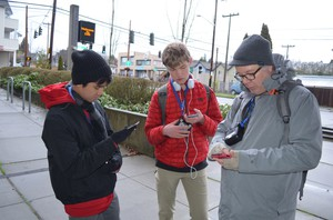After their walk, John Hoac, Brandon Teeny, and Troy Abel take stock of the pollution they mapped on their walk around campus.
