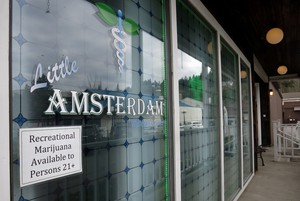 A budtender at the Little Amsterdam marijuana store in Portland, say sales are doubling in advance of the Aug. 21 total eclipse.