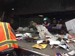 Workers at the FarWest recycling facility in Hillsboro, Oregon, pull out contaminants like plastic and rope from the recycling that people put in their curbside recycling bins.
