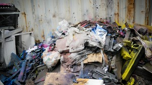 A pile of printer parts dusted with toners like carbon black, a possible carcinogen known to cause respiratory problems.