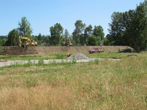 A former landfill in Northeast Portland needs some clean-up before it can be redeveloped into a Buddhist community center.