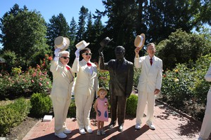 Royal Rosarians -- and one honorary Rosarian -- pose for a photo at the 100 year celebration of the International Rose Test Garden in Portland.