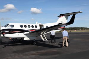 PacifiCorp executives board the company plane at Portland International Airport.
