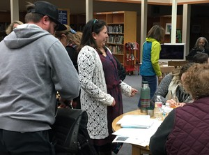 Shandiin Garcia jokes with a table of teachers during a teach in session for 4th grade teachers in the 4J school district. Garcia is with Education Northwest, which is developing state mandated curriculum.