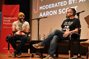 "Joseph Fink (left) and Jeffrey Cranor (right), the creators of the podcast, ""Welcome to Nightvale"", and authors of the novel ""It Devours!"", onstage at Wordstock 2017."