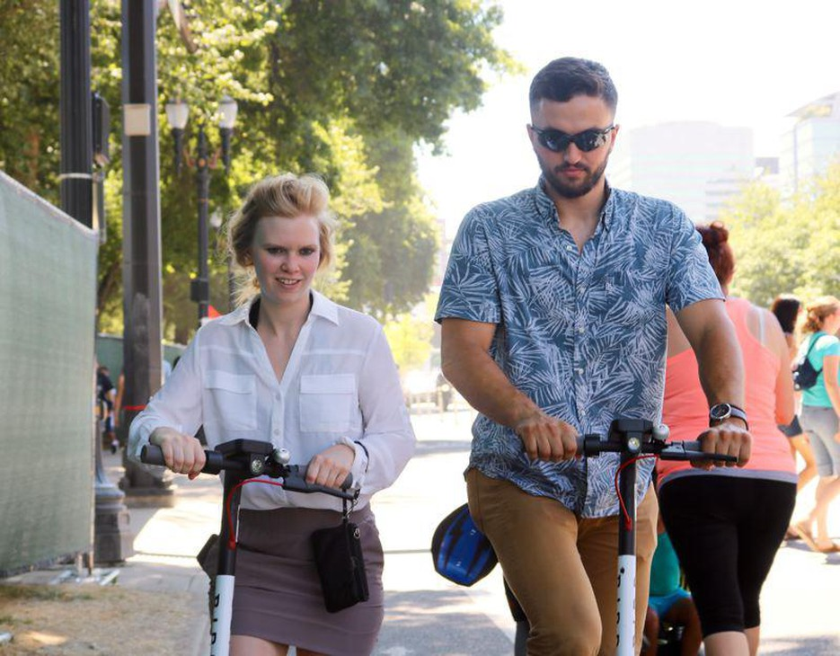 """Sam Kane and Caitlin Drost say Bird brand electric scooters are """"super fun"""" and """"pretty awesome,"""" respectively."""