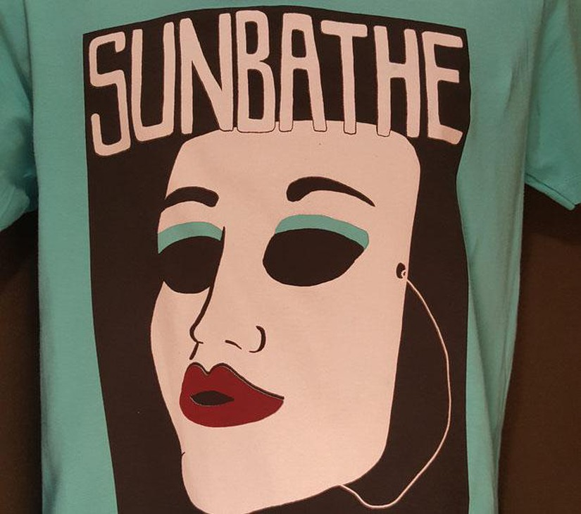 Portland band Sunbathe offers a t-shirt with a mask on it that, according to our expert, could be fashioned into a mask.
