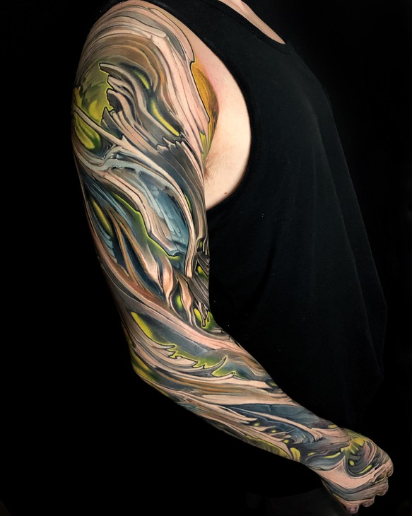 An example of Bob Jones' ink armor. Growing from a biomechanical tattoo style, Jones explores illusions of plating and robotics on the skin.