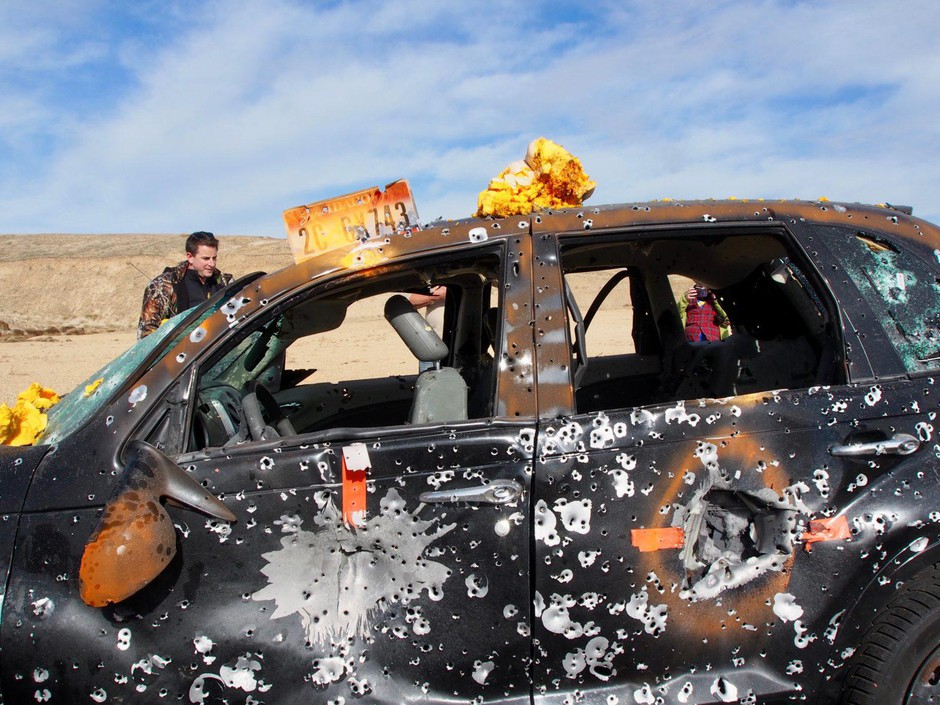 A bullet-pocked PT Cruiser after the Idaho Automatic Weapons Collectors' Association annual Pumpkin Shoot at the Black's Creek Public Shooting Range, east of Boise, Idaho.