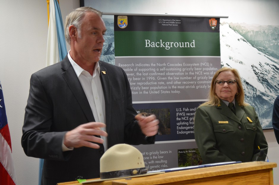 Interior Secretary Ryan Zinke speaking on March 23, 2018, about the restarted re-introduction process for grizzly bears in Washington's North Cascades. Looking on is Karen Taylor Goodrich, the superintendent of the North Cascades National Park Service Complex.