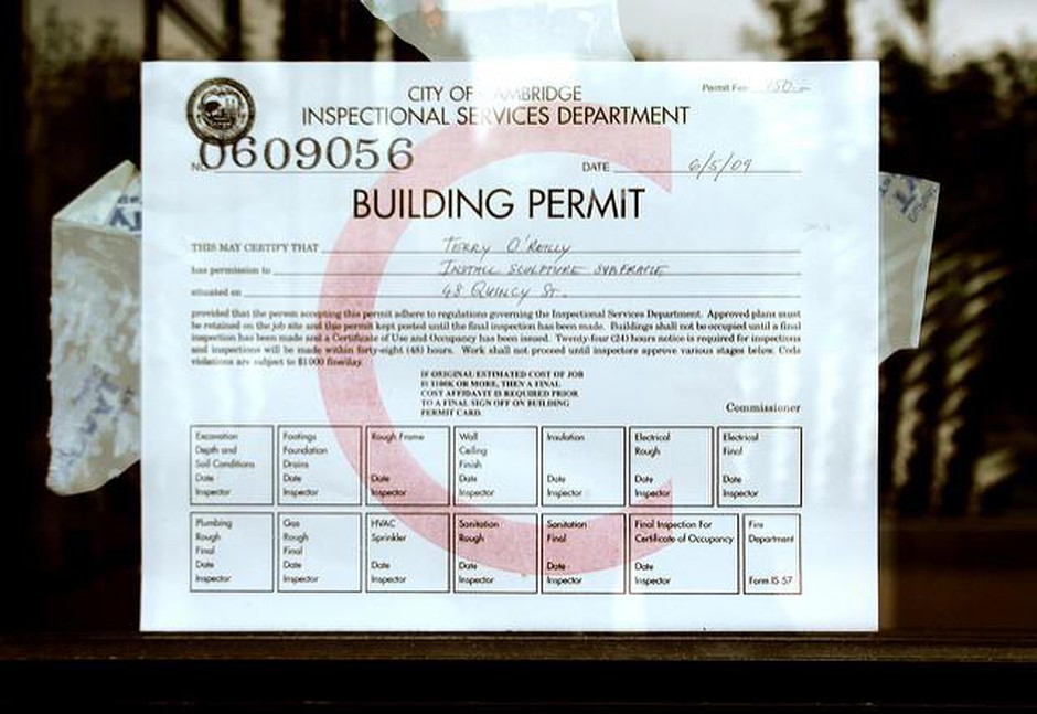Several small towns in Oregon allow private companies to issue building permits. That violates the state constitution, says the Department of Justice. But according to the towns, it also keeps construction costs down.