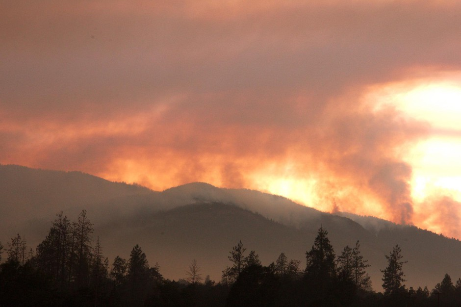 The smoke of the Taylor Creek Fire still plumes behind the Joint Information Center, just outside of Grants Pass, OR.
