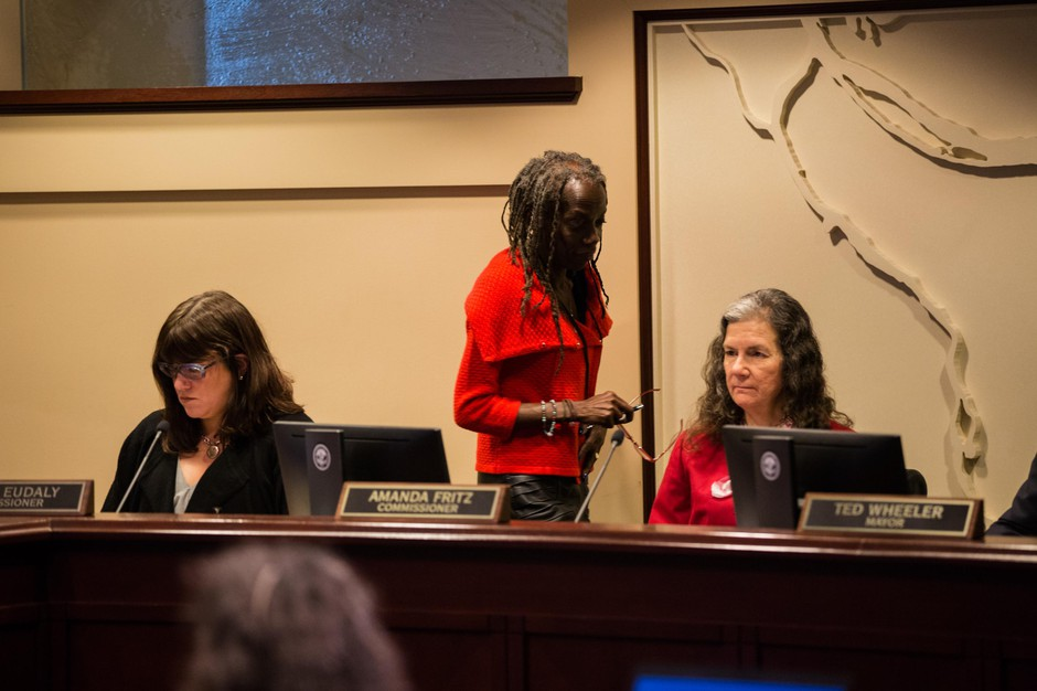 Portland Commissioner Jo Ann Hardesty walks past Commissioners Chloe Eudaly and Amanda Fritz at the Portland City Council meeting Wednesday, Feb. 13, 2019 in Portland, Ore. The council voted to withdraw the city from the FBI-led Joint Terrorism Task Force.
