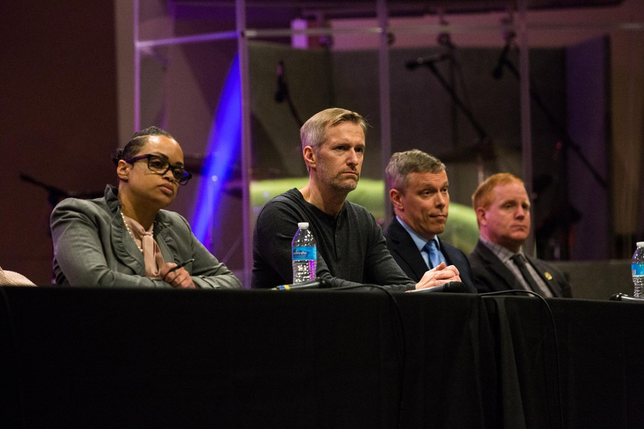 Portland Police Chief Danielle Outlaw, Mayor Ted Wheeler, Assistant Chief Chris Davis and Deputy Chief Bob Day listen during a community listening session at Maranatha Church in Portland, Ore., Thursday, Feb. 21, 2019. City leaders called the meeting to hear community concerns over a police lieutenant's text messages with Patriot Prayer leader Joey Gibson.