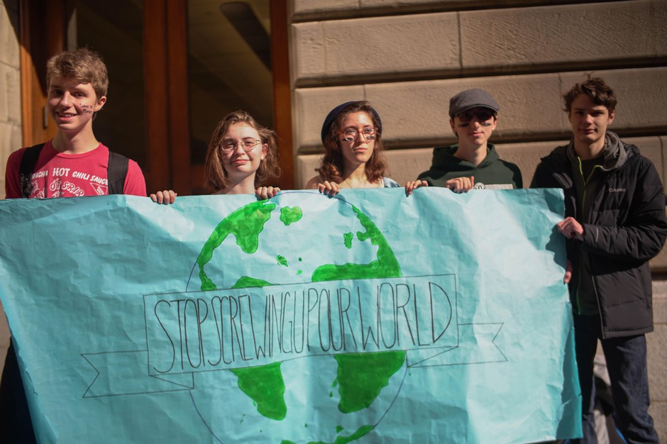 Portland students hold a sign during the Global Climate Strike in front of Portland City Hall.