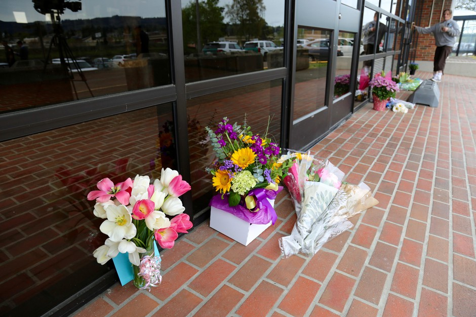 Flowers and candles left outside the Cowlitz County Hall of Justice in honor of Deputy Justin DeRosier.