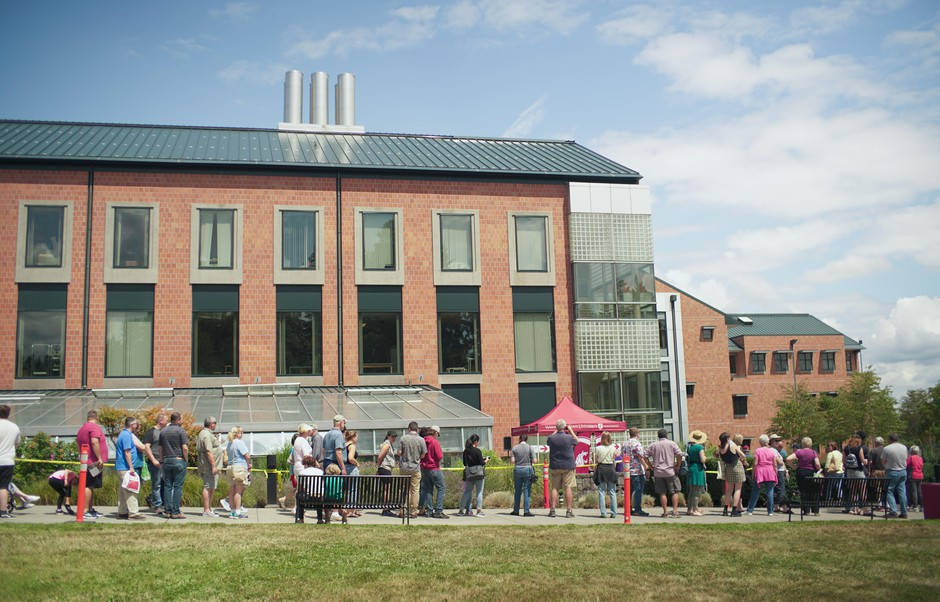 People wait in line to see the corpse flower Titan VanCoug on the Washington State University campus in Vancouver, Wash., Tuesday, July 16, 2019.