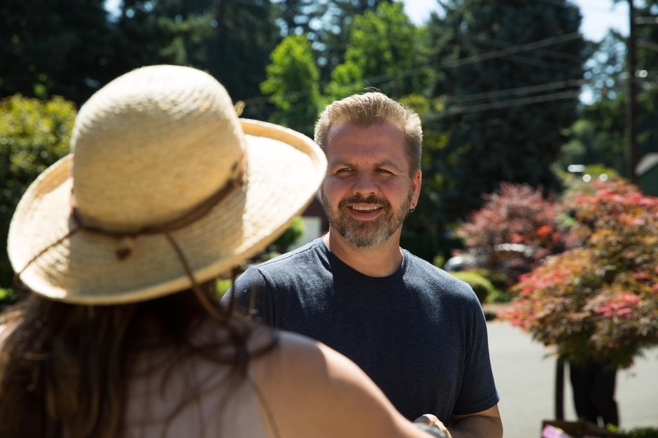 Maywood Park Mayor Matthew Castor speaks with a resident while he walks around the city on Saturday, July 20, 2019.
