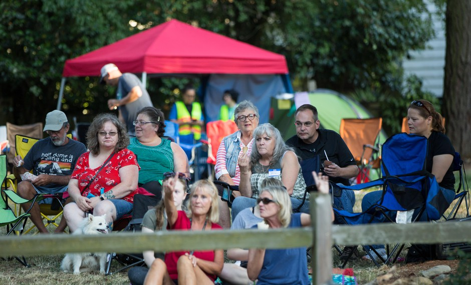 Residents listen to a band performing at the annual National Night Out event in Maywood Park, Ore., on Saturday, July 27, 2019.