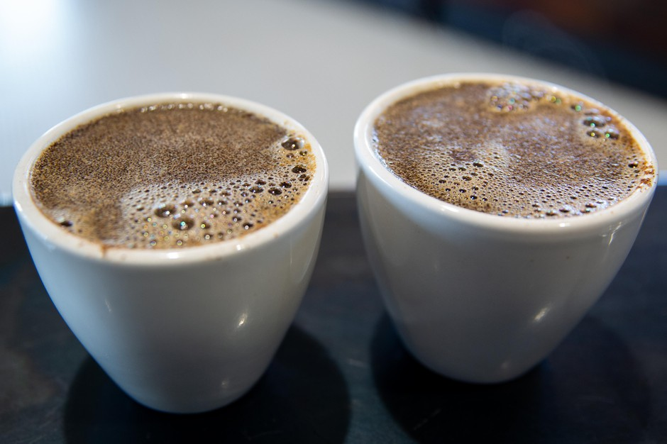 Acrust develops on the top of a cup of coffee, trapping the coffee's aroma underneath.