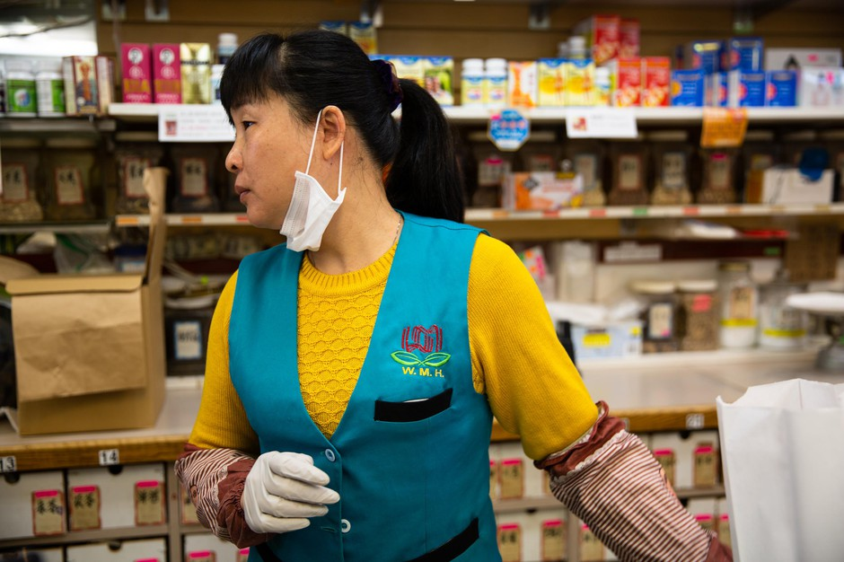 Zhong Yz works behind the counter at Wing Ming Herbs in Portland, Ore., Tuesday, Feb. 18, 2020.