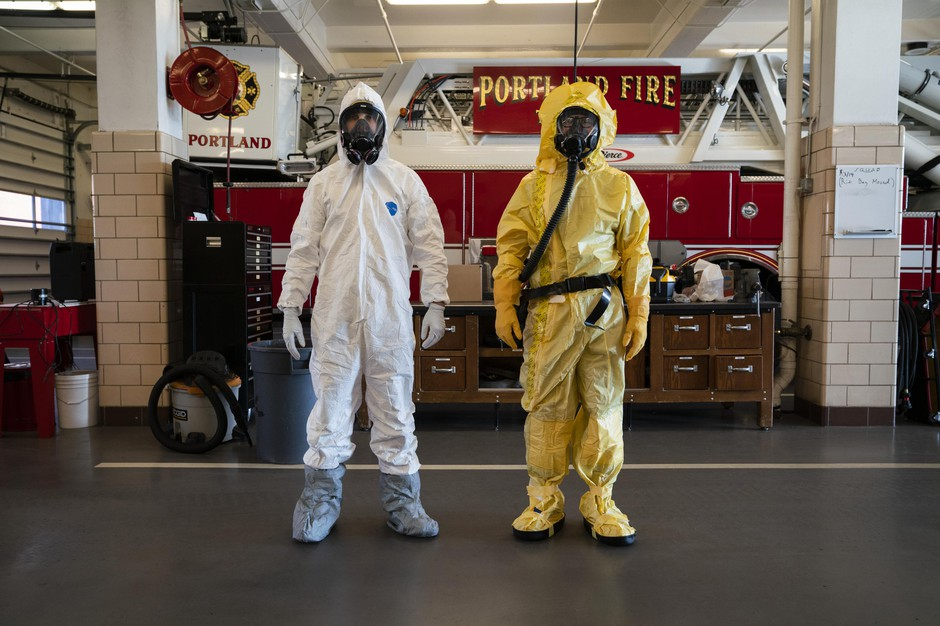 Emergency dispatchers in Portlandwill now try and ask callers about out-of-state travel, known exposure to the virus and any symptoms they may have. If the caller seems likethey may have contracted COVID-19, firefighters might choose to wear either of the two protective suits, worn above byKevin Leonard (left) and Bozeb Beckwith (right).