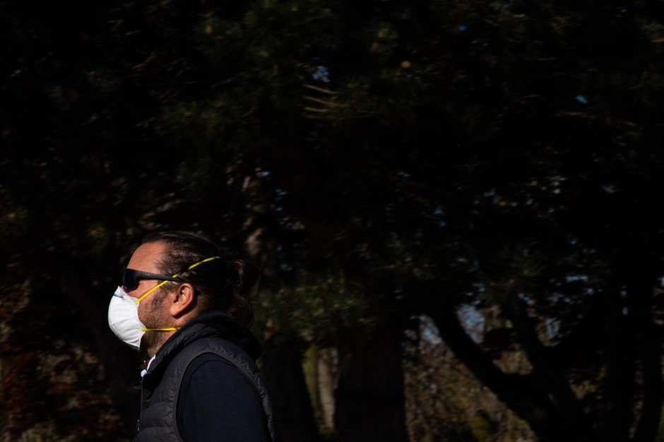 A man wearing a respirator takes a walk Tuesday, April 14, 2020, in Portland, Ore. Local health officials have recommended wearing PPE like masks and gloves to slow the spread of COVID-19.