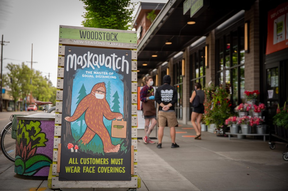 A sign at the Woodstock location of New Seasons Market in Portland, Ore., alerts customers that they must wear face masks while shopping on Wednesday, April 29, 2020.
