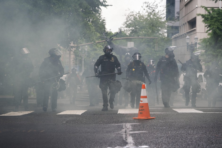 Portland police used tear gas and rubber bullets to disperse protesters from near the Justice Center an hour before the 8p.m. curfew went into effect on May 30, 2020. The protests were against racist violence and police brutality in the wake of the killing of George Floyd by a white Minneapolis police officer.