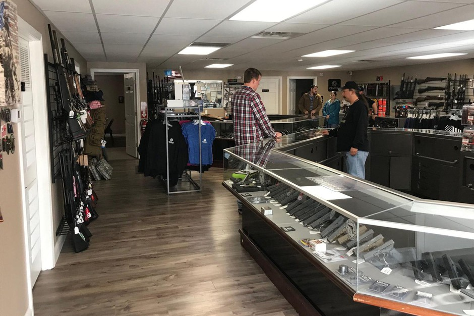A customer who recently moved from Massachusetts speaks with a clerk at Central Connecticut Arms about Connecticut state gun regulations.