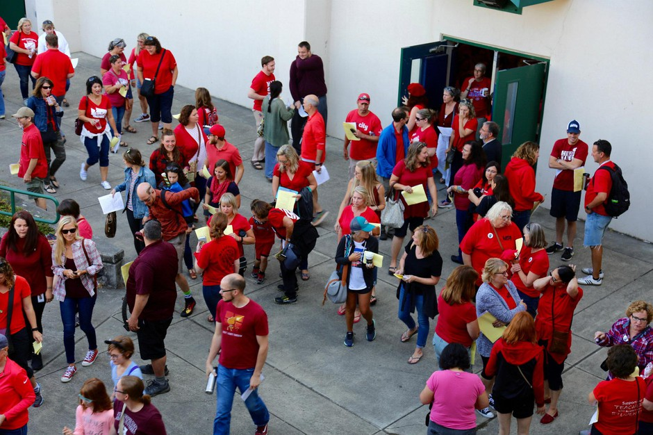 Vancouver teachers pour out of Skyview High School following vote to ratify a new contract Tuesday, Sept. 4, 2018.
