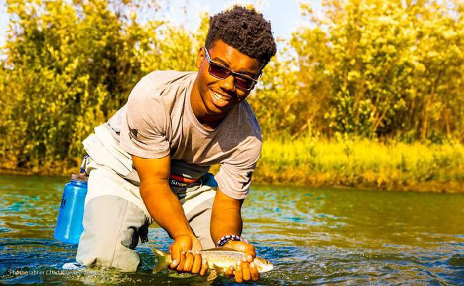 Tara Cooper's son Andre Tharp fly fishing in theArctic Circle in the Venati Village and immersion with the Gwich'in Nation as part of Soul River's deployment in the summer of 2018.