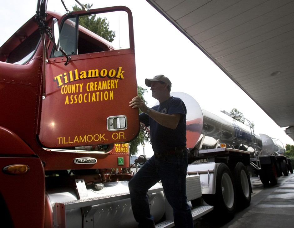 A Tillamook Dairy milk truck driver prepares to leave after delivering two tanker truck loads of milk to Alpenrose Dairy in Beaverton, Ore.,