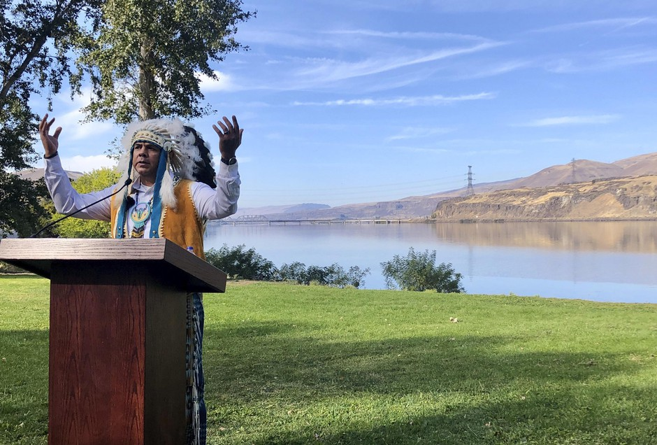 JoDe Goudy, chairman of the Yakama Nation, speaks with the Columbia River in the background near The Dalles, Oregon, on Monday, Oct. 14, 2019, where Celilo Falls, an ancient salmon fishing site was destroyed by the construction of the Dalles Dam in the 1950s.