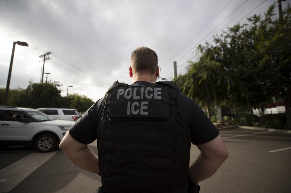 In this July 8, 2019, file photo, a U.S. Immigration and Customs Enforcement (ICE) officer looks on during an operation in Escondido, Calif. U.S. Immigration and Customs Enforcement subpoenaed a sheriff's office in the suburbs of Portland, Oregon, on Tuesday, Feb. 18, 2020, for information about two Mexican citizens wanted for deportation, a move that is part of a broader escalation of the conflict between federal officials and local government agencies over so-called sanctuary policies.