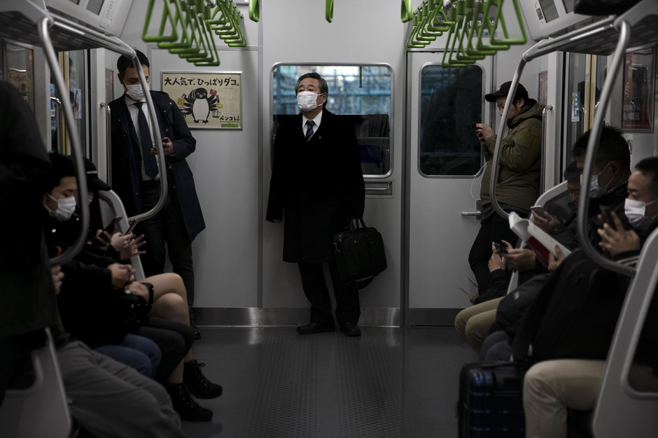 People wearing masks commute in a train in Tokyo, Tuesday, March 3, 2020. The Japanese government has indicated it sees the next couple of weeks as crucial to containing the spread of COVID-19, which began in China late last year.