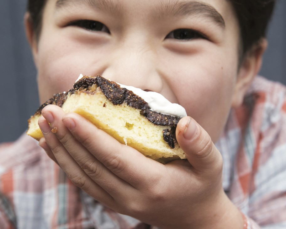 "Rachel Yang's older son, Pike Chirchi, 7, takes a bite of Upside-Down Fig Mochi Cake with Bleu Cheese Whip from her cookbook ""My Rice Bowl, Korean Cooking Outside the Lines."" The sweet-savory ""dessertish"" rice cake can be made with dried apricots instead of Mission figs."