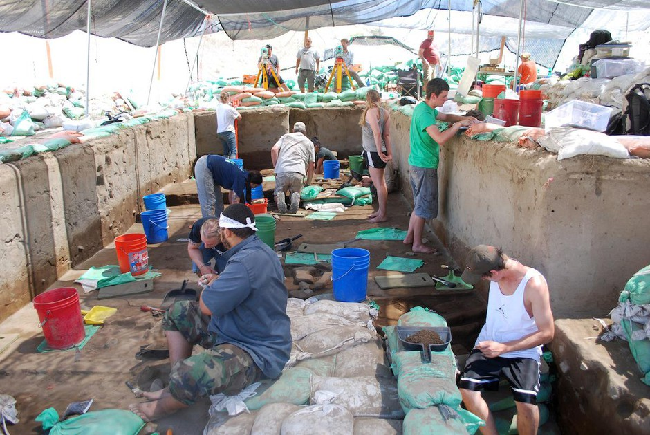 Archaeologists work to excavate ancient human artifacts at Cooper's Ferry in Western Idaho.