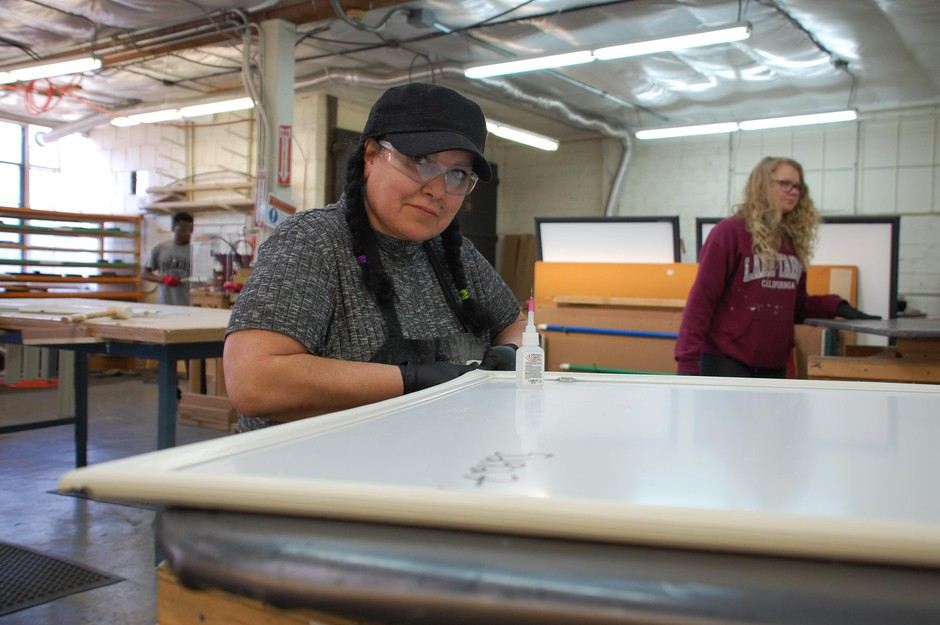 Melanie Baca helps produce window inserts at the Portland company Indow on March 16, 2020. Most employees started working from home during the coronavirus pandemic, but the factory workers can't do that.
