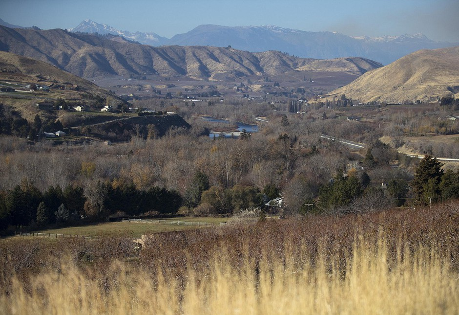 Orchards are shown in the foreground of the Wenatchee Valley on Monday, Nov. 19, 2018, in Wenatchee.