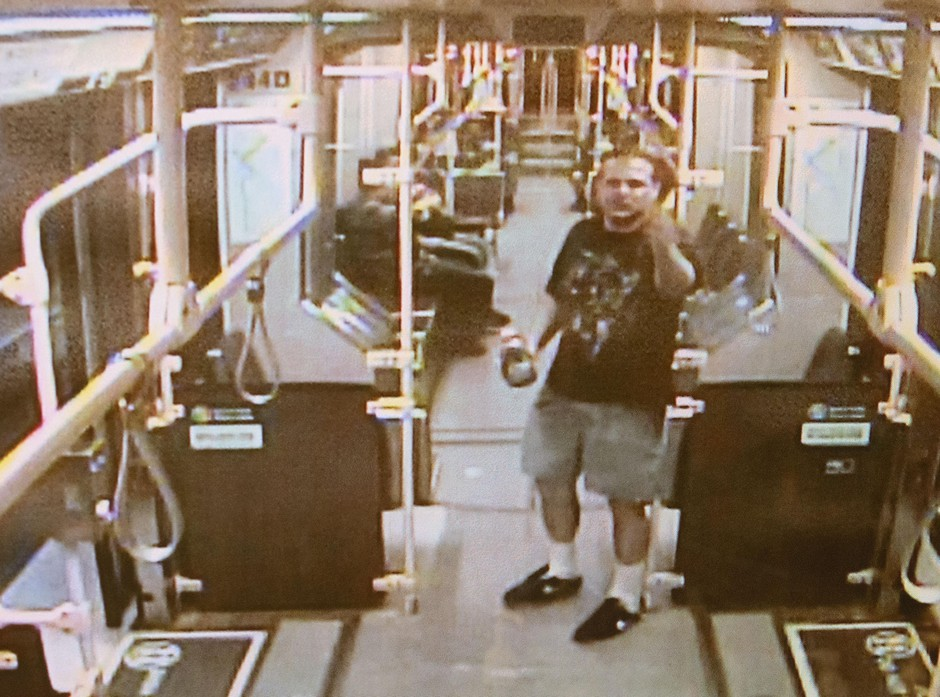 Stills from TriMet video are shown during the Jeremy Christian trial at the Multnomah County Courthouse in Portland, Ore., Jan. 31, 2020. The images showed Christian yelling aboard a MAX light rail train the night he allegedly assaulted Demetria Hester.
