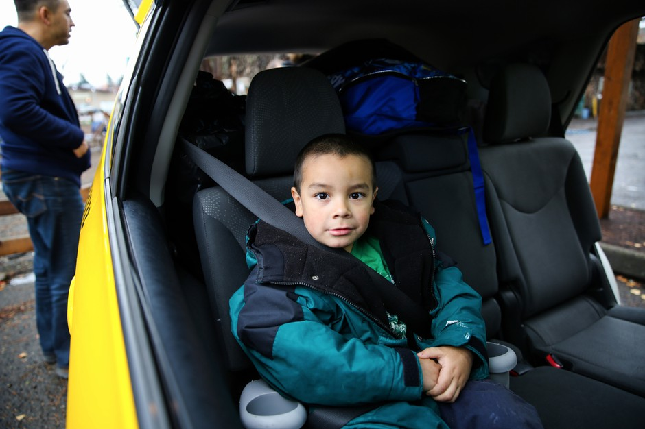 Michael Bunch, 4, sits in a car on what was moving day for his family.Until then, Michael had never had a home of his own.