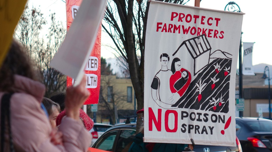 Advocates at a protest in Medford say new Oregon OSHA rules won't protect farmworkers.