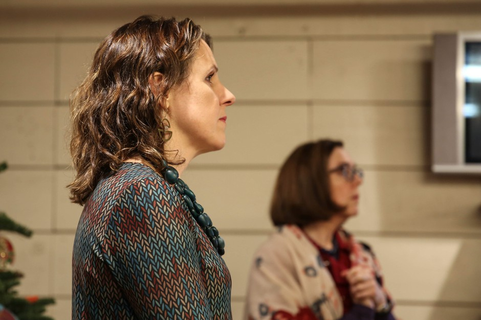 Multnomah County Chair Deborah Kafoury (left) and Oregon Gov. Kate Brown listen during visit to the Human Solutions Family Shelter in December 2017.