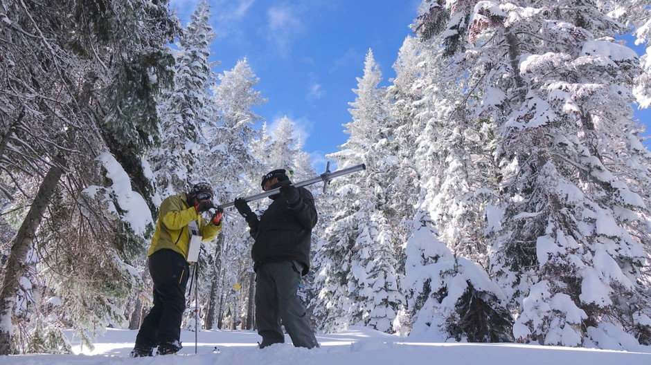 Ben Thorpe (left) and Shavon Haynes measure the snowpack on Mount Ashland.